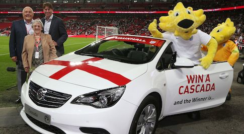 Football legend presents lucky England fan with Vauxhall Cascada