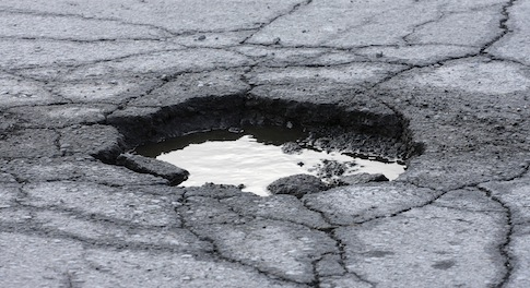 Government pledges �illion to rid the UK of potholes
